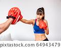 Beautiful woman female practice boxing training 64943479
