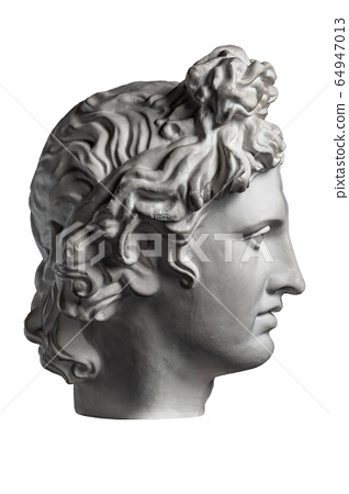 White gypsum copy of ancient statue of Apollo God of Sun head for artists on a white background. Plaster sculpture of man face. Renaissance epoch. Portrait. 64947013