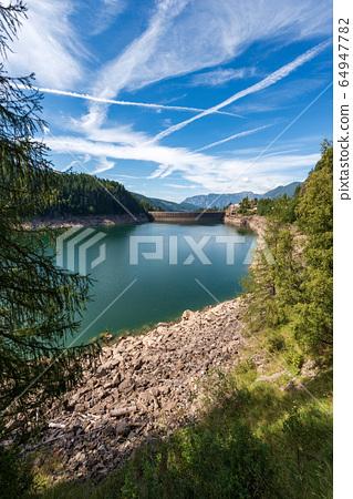 Alpine lake with dam - Lago di Paneveggio Trentino Alto Adige Italy 64947782