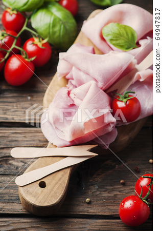 Italian traditional prosciutto with tomato and 64947817