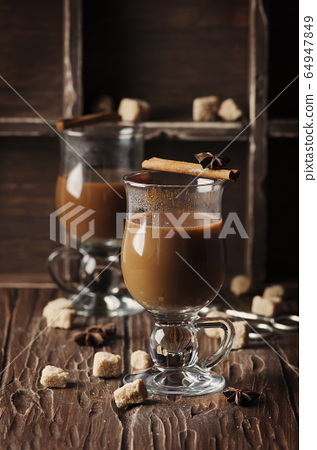 Hot american coffee with cinnamon on the vintage 64947849
