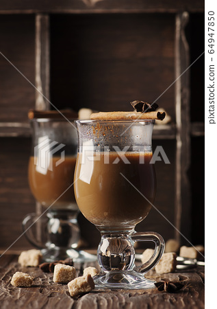 Hot american coffee with cinnamon on the vintage 64947850
