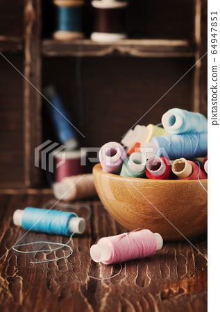 Color threads on the vintage table 64947851