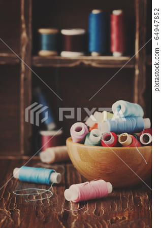 Color threads on the vintage table 64947852