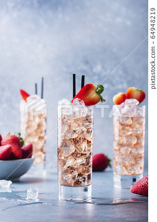 summer cocktail with strawberry and ice 64948219