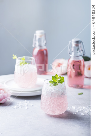 Pink cocktail with crushed ice 64948234