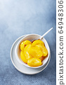 Sweet canned peaches 64948306
