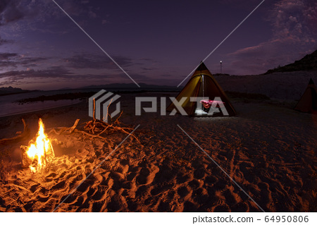 tent camp in desert sandy beach in california at 64950806