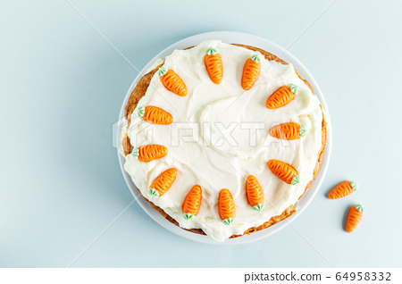 Easter carrot cake with frosting on blue 64958332
