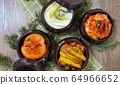 Korean different kinds of Kimchi  in traditional dishes  64966652