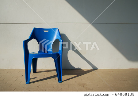 Art of Blue chair with oblique light background 64969139