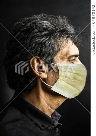 Portrait of Caucasian man with surgical mask 64970142