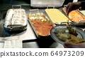 Display of food at an evening buffet at a tourist 64973209