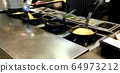 Cooking omelettes and fried eggs. Breakfast buffet 64973212