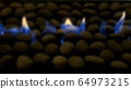 Blue gas fire roaring through small stones on the 64973215