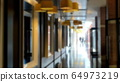 Long corridor in the modern hotel with people on 64973219