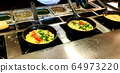 Cooking omelettes and fried eggs. Breakfast buffet 64973220