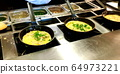 Cooking omelettes and fried eggs. Breakfast buffet 64973221