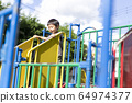 Children playing in the park 64974377