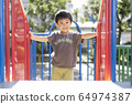Children playing in the park 64974387