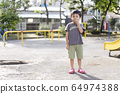 Children playing in the park 64974388