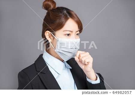stress young woman wear medical mask and  cough 64982057
