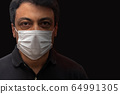 Man with mask on black background. Protection 64991305