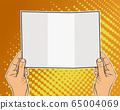 Male hand of caucasian man holding a card. 65004069