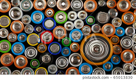 Close up background of various alkaline batteries 65013830