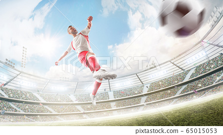 Soccer kick. Professional soccer player in action. Daytime 3d stadium with fans, lights and flags. Wide angle. Sport 65015053