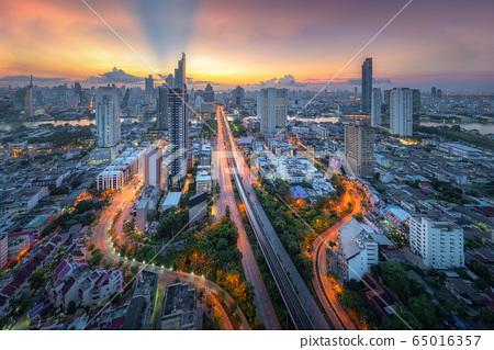 Amazing beautiful view of midtown Bangkok city skyline and skyscraper at sunset. 65016357
