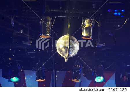 Light and music rotating mirror ball and lights in musical theater. 65044126