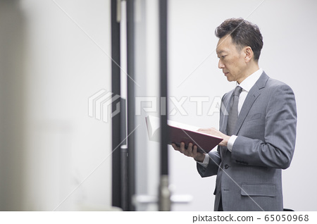 Middle-aged businessman reading books