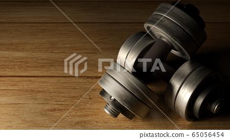 The dumbbells  wood floor dark tone 3d rendering for fitnesses content. 65056454
