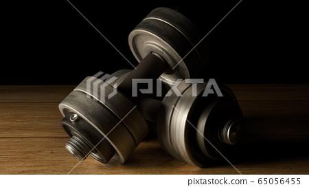 The dumbbells  wood floor dark tone 3d rendering for fitnesses content. 65056455