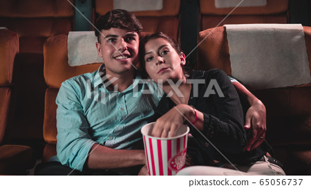People audience watching movie in cinema theater. 65056737