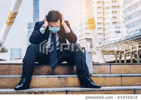 Unhappy sad business man with face mask protect 65056828