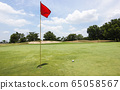 Red flag at the beautiful golf course of golf course 65058567
