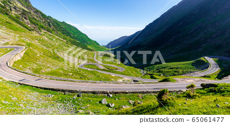 winding mountain road on a sunny day. empty 65061477