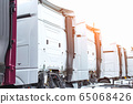 European trucks stand in a row with spacious comfortable cabs, industry. Copy space 65068426