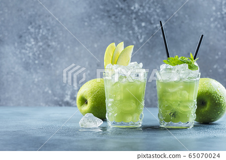 Green cocktail with ice and mint 65070024