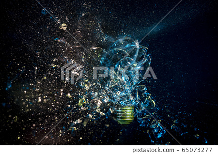 explosion of a glass bulb on black. High speed 65073277