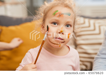 Child Painting On Face 65078620