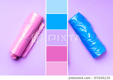 Plastic bags colorful rolls on purple. Color swatch 65088226