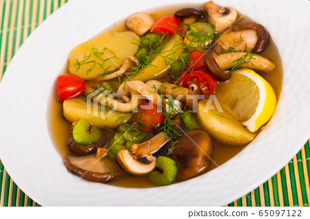 Mushroom broth prepared with boiled honey fungus and vegetables 65097122