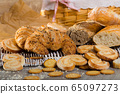 Assortment of fresh bread and bakery products 65097273