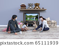 Suffering from going out, spending time with his father, mother, children and pet dog in the family 65111939