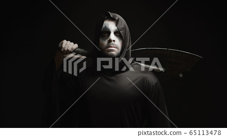 Grim reaper over black background with axe in his hands 65113478