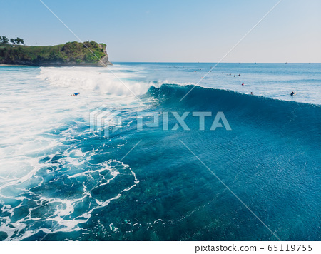 Surfing waves in ocean and shore. Aerial view of surf spot. 65119755