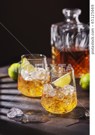 Cuban strong rum with ice and lime 65125669